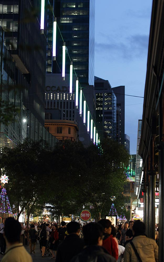 The Pitt Street Mall catenary lighting system illuminates the pedestrian areas below and the facades of the buildings, without needing large self-standing poles or heavy-looking supports