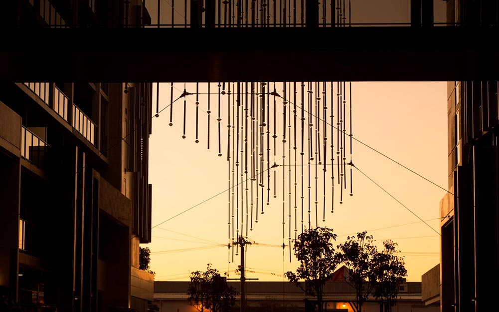 Aurora Catenary Lighting Sculpture – suspended artwork by Stuart Green and Ronstan Tensile Architecture at dusk
