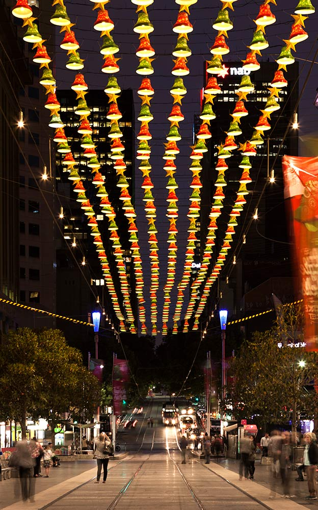 The tensile cable net provides both functional and seasonal decorative catenary lighting