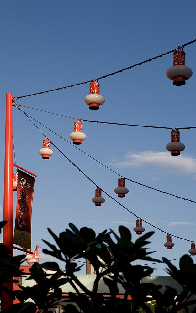 Brisbane Chinatown catenary lighting system with custom made light fittings