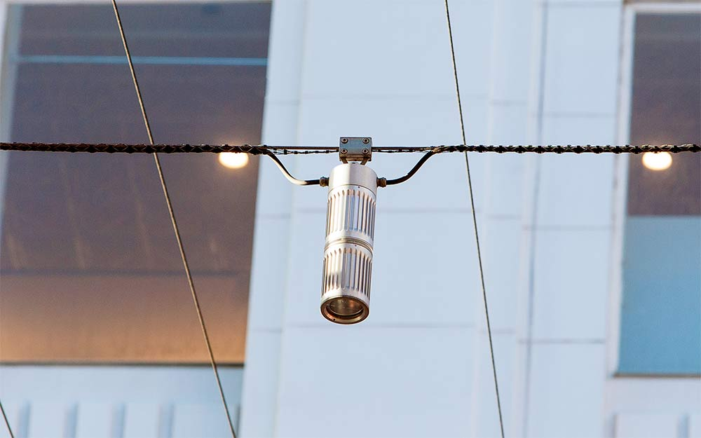 Detail of a traditional catenary lighting luminaire over Bourke Street Mall