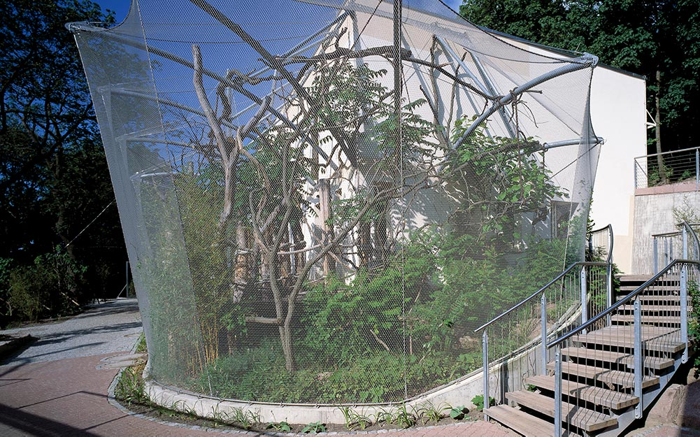 The wire mesh Marmoset Monkey enclosure at Halle Zoo in Germany perfectly illustrates why Carl Stahl X-TEND stainless steel cable mesh is so appealing for use in zoological enclosures