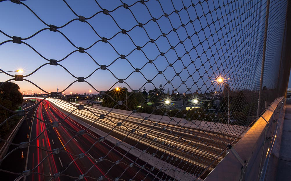 It was considered critical to the design for the new bridge to incorporate an anti-throw and fall protection barrier to better protect the undercarriage traffic from potential projectiles or fallen objects from the new bridge. This presented the perfect opportunity for Ronstan to install X-TEND mesh, presenting a transparent and non-invasive wire mesh solution that would provide the adequate protection without disrupting the design intent.