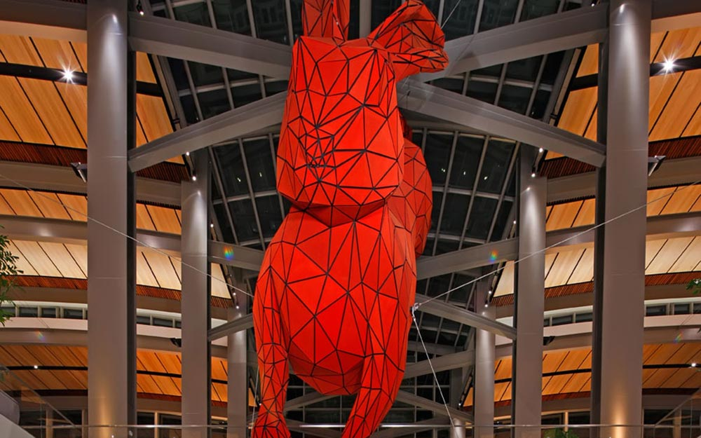 This suspended sculpture was installed as the centerpiece of several art exhibits commissioned by the Sacramento Metropolitan Arts Commission. Ronstan provided multiple ACS2 Stainless Steel Cables that bear the full weight of the suspended sculpture yet appear nearly invisible in contrast to the bright red rabbit.