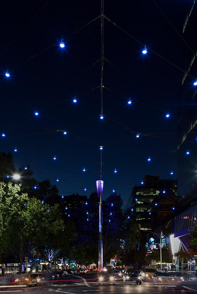 """Lonsdale Gateway"", the Ronstan catenary lighting structure at the intersection of Lonsdale and Russell Streets in Melbourne, celebrates entry into the city's Greek precinct"