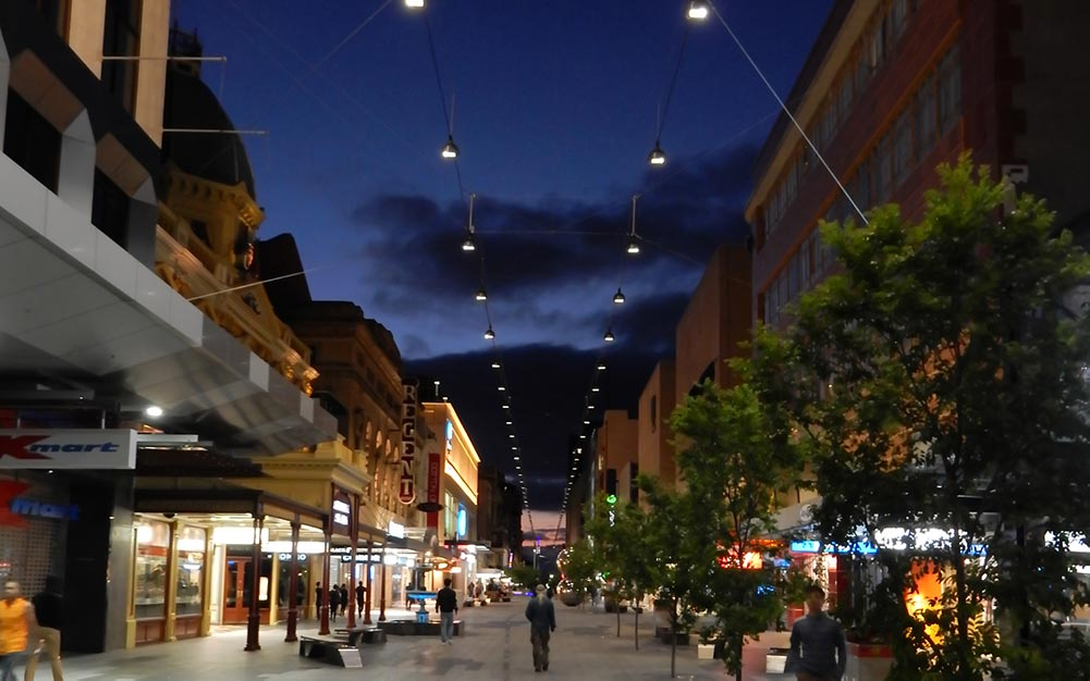 The Rundle Mall Catenary Lighting System invite pedestrians to enjoy the inviting and warm environment created by the suspended luminaires