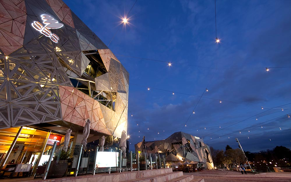 Federation Square catenary lighting system at dusk