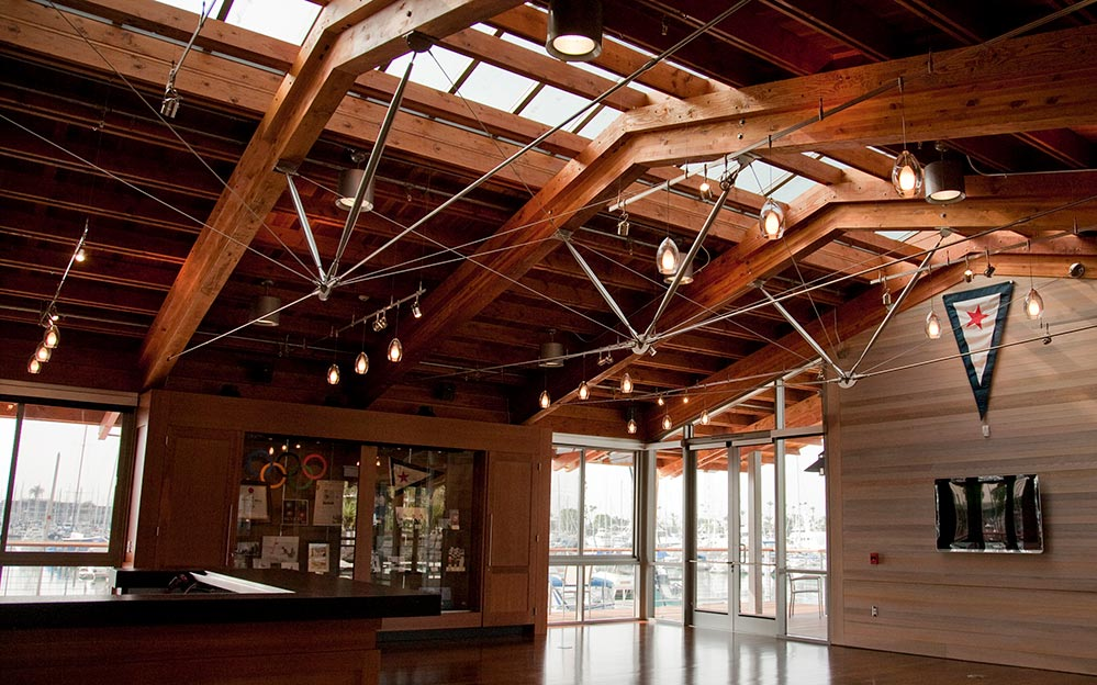 Ronstan Tensile Architecture provides sleek architectural tension rod systems to the San Diego Yacht Club's new Malin Burnham Sailing Center in San Diego, CA. The systems, which act as cross bracing and web compression struts, brace the Center's timber roof trusses.