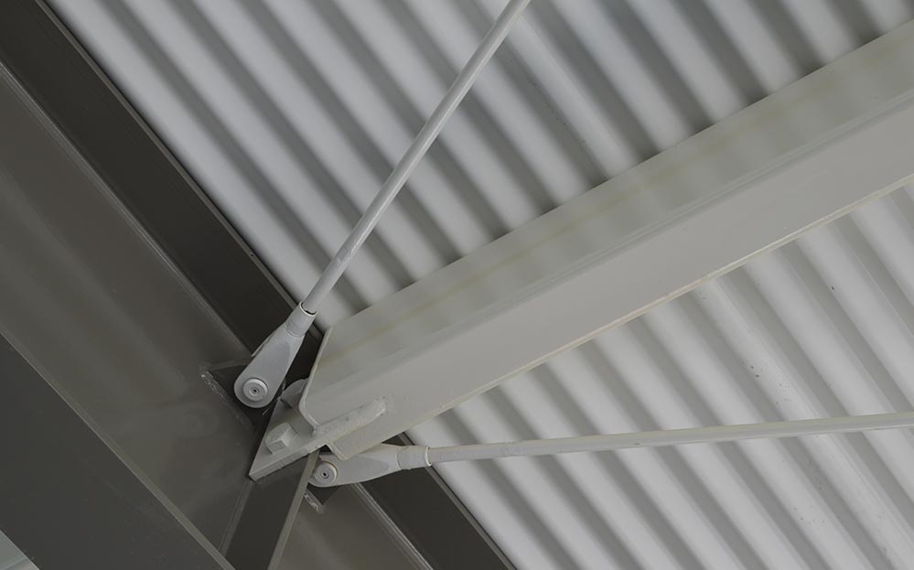 The curved steel structure of the new St Joseph's College cantilevered awning required exposed bracing to stabilise. Ronstan ARS Rods were architecturally specified to deliver the most aesthetically appealing solution, and highlighted in the engineering design due to their high tensile strength.