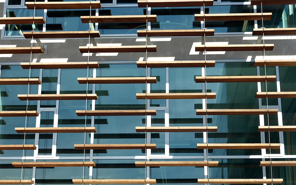 The Smales Farm facade louver system is a fantastic example of a tensioned facade that is both aesthetic and functional. It responds to its context with an aesthetic and functional passive solar design for today's climate.